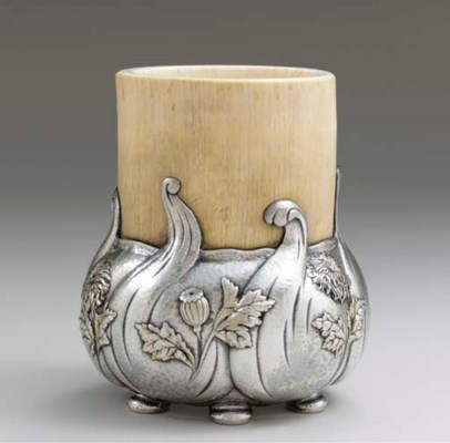 A SILVER-MOUNTED IVORY AND PAR