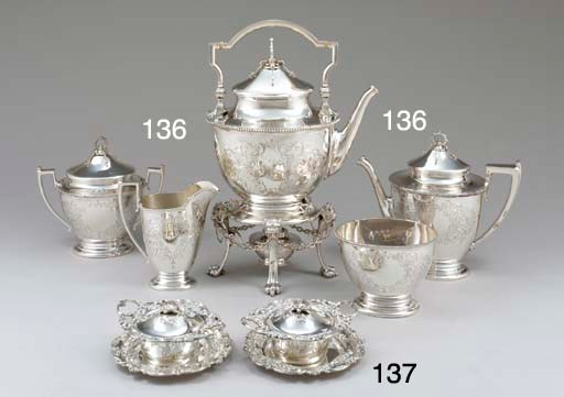 A SET OF TWELVE SILVER COVERED