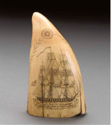 A SCRIMSHAW WHALE TOOTH