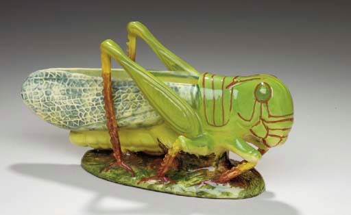 A FRENCH MAJOLICA GRASSHOPPER