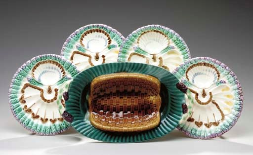 FOUR FRENCH MAJOLICA TROMPE L'