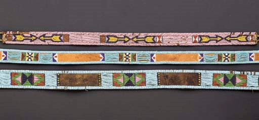 A GROUP OF THREE PLAINS BEADED