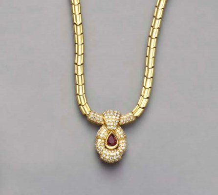 A RUBY, DIAMOND AND 18K GOLD N