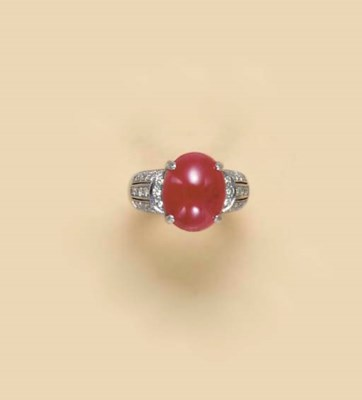 A CABOCHON RUBY, DIAMOND AND 1