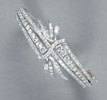 A DIAMOND AND 14K WHITE GOLD B