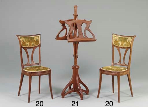 A CARVED MAHOGANY MUSIC STAND