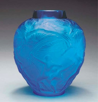 'ARCHERS', A BLUE GLASS VASE