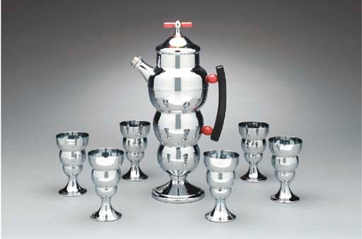 A CHROMED METAL AND RED BAKELI