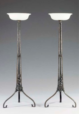 A PAIR OF WROUGHT-IRON TORCHER