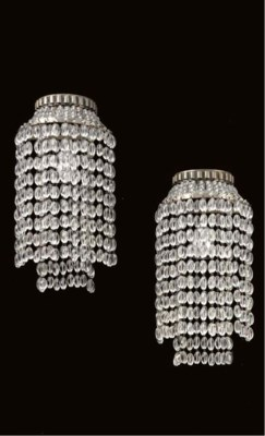 A PAIR OF SILVERED METAL AND B