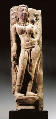 A Red Sandstone Figure of a Ce