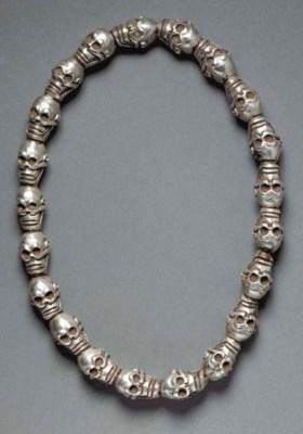 A Silvered Bronze 21-Skull Mal
