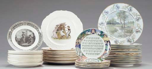A SET OF TWELVE LIMOGES DINNER