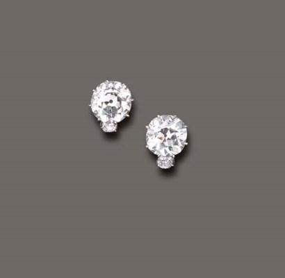 AN ELEGANT PAIR OF DIAMOND EAR