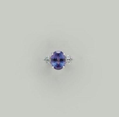A TANZANITE, DIAMOND AND WHITE
