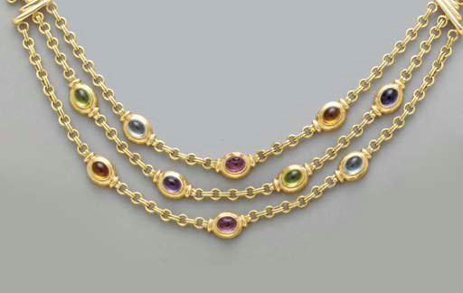 A MULTI-GEM AND 18K GOLD NECKL