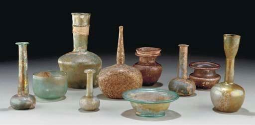 THIRTEEN ROMAN GLASS VESSELS