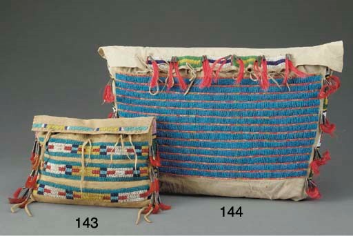 A SMALL SIOUX BEADED HIDE POSS