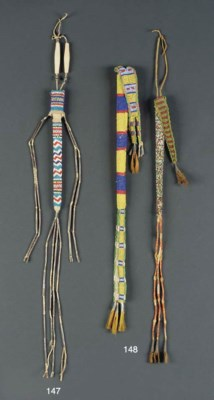 TWO SIOUX BEADED HIDE AWL CASE