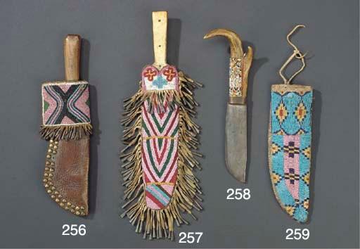 A SIOUX BEADED HIDE KNIFE SHEA