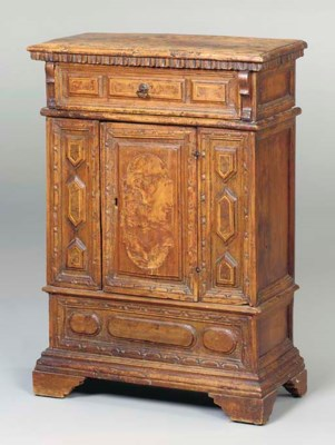 A CARVED AND INLAID CREDENZA,