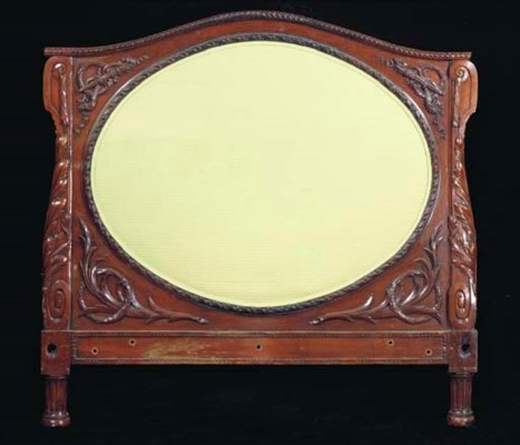 A LATER VICTORIAN CARVED MAHOG