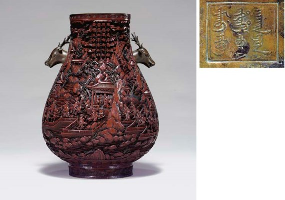 AN UNUSUAL CARVED DARK RED AND