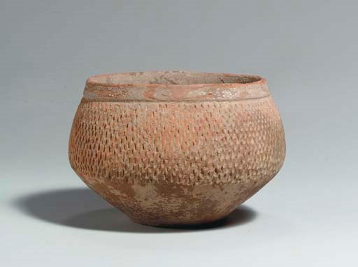 A SMALL IMPRESSED RED POTTERY