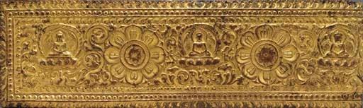 A Gilt Copper Repoussé Manuscr