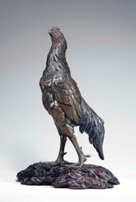 A Patinated Bronze Model of a