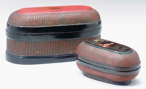 AN OVAL BOX WITH A RED AND BLA