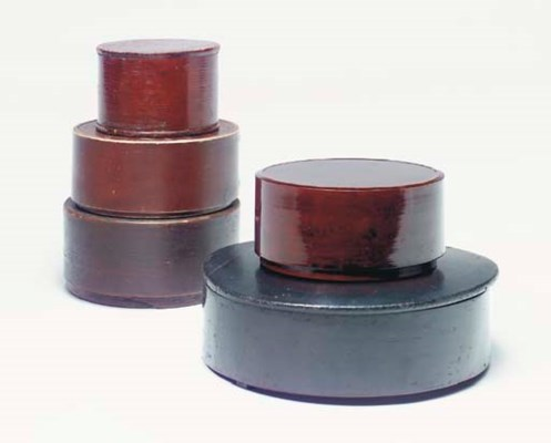 A GROUP OF ROUND BOXES,