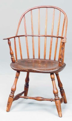 AN ATTENUATED WINDSOR ARMCHAIR