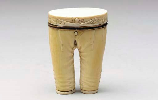 A CARVED IVORY TROUSER-FORM TA