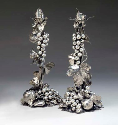 A PAIR OF SILVER CANDLESTICKS,