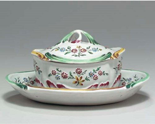 A FRENCH FAIENCE SAUCE-TUREEN