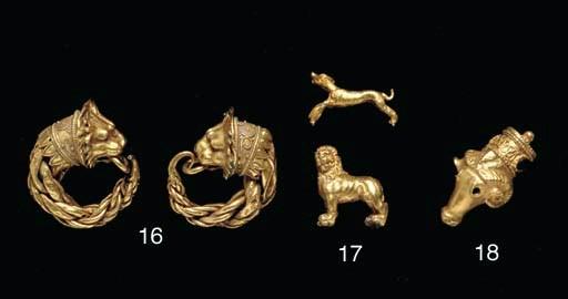 A PAIR OF GREEK GOLD LION HEAD