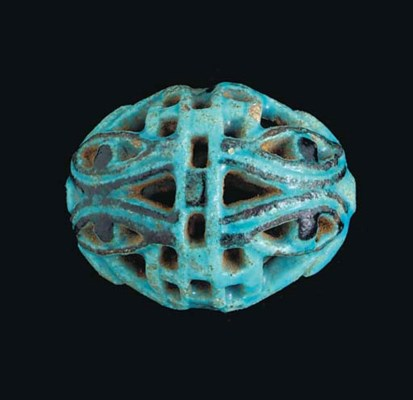 AN EGYPTIAN FAIENCE OPENWORK W