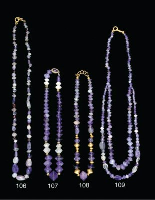 A ROMAN GOLD AND AMETHYST BEAD