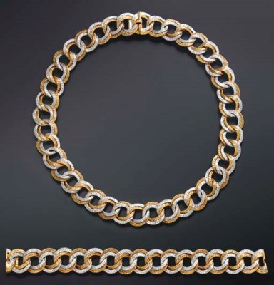 A SUITE OF BICOLORED GOLD JEWE