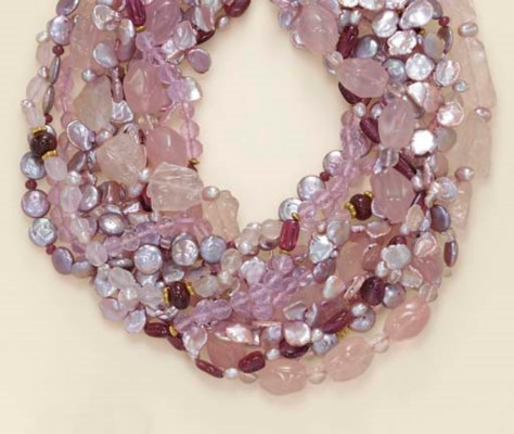A MULTI-STRAND ROSE QUARTZ, CU