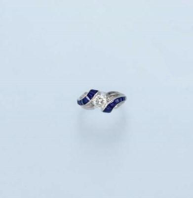 A DIAMOND AND SAPPHIRE RING, B