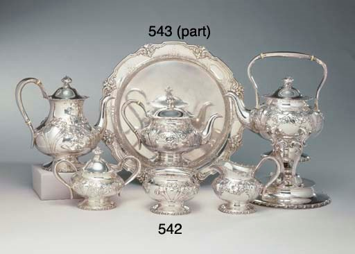 A GROUP OF SILVER SERVING ITEM
