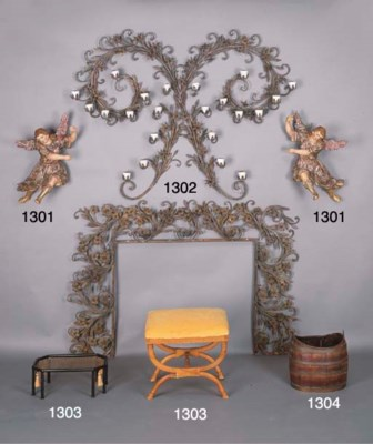 A WROUGHT-IRON FIRE SURROUND