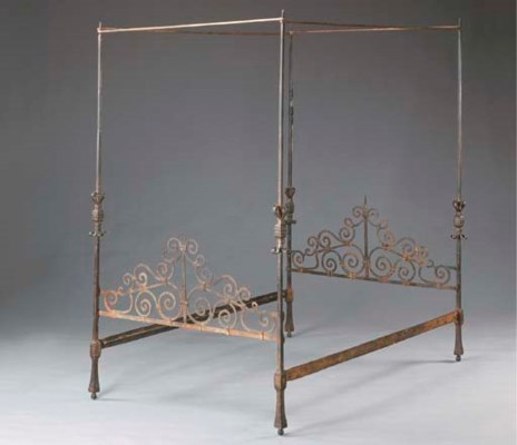 A SPANISH GILT-WROUGHT-IRON BE