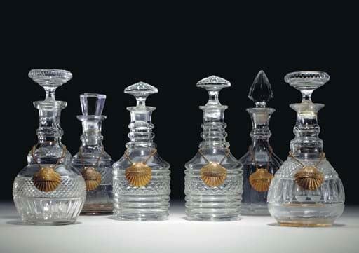 SIX CUT-GLASS DECANTERS AND FO