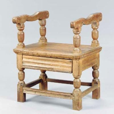AN OAK CHAIR TABLE BASE