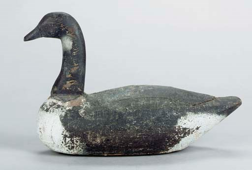 A PAINTED CARVED GOOSE DECOY W