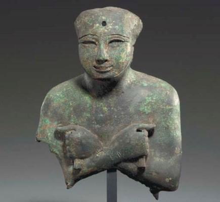 AN EGYPTIAN GILT BRONZE BUST O
