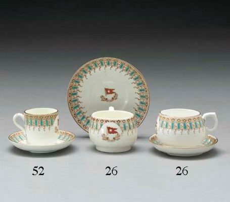 Two coffee cups, a saucer and